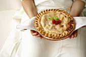 Woman Holding Freshly Baked Fruit Pie