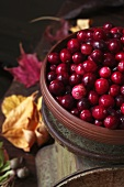 Bowl of Fresh Cranberries on an Old Scale; Autumn Leaves