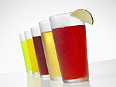 Glasses of Various Juices on White Background