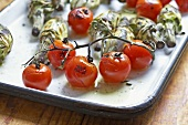 Grilled Cherry Tomatoes on the Vine with Baby Artichokes; On Serving Tray