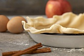 Unbaked Pie Crust in Baking Dish; Pie Ingredients