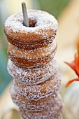 Homemade Old Fashioned Sugared Donuts on a Metal Skewer