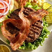 Grilled Bacon Burger with Lettuce; Top Bun Off; Pickles