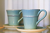 Blue Ceramic Mugs with Saucers