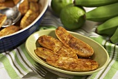 Baked Plantains in a Bowl; Baking Dish and Fresh Plantains