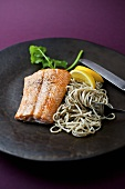 Arctic Char with Soba Noodles on a Black Plate