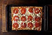 Rectangular Tomato and Onion Pizza on Baking Sheet
