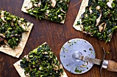 Pizza Topped with Mushrooms and Greens; Slices; Pizza Cutter