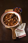 Bowl of Hungarian Beef Goulash Made with Paprika on a Cutting Board; Bowl of Paprika