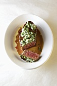 Beef steak with herb butter, partly sliced