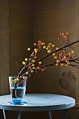 Crab Apple Branch in a Blue Vase on a Table