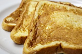 Three Pieces of French Toast on a Plate; Close Up