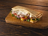 Flatbread Sandwich with Turkey, Swiss Cheese, Lettuce, Tomato, Onion and Banana Peppers