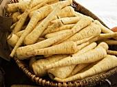 Basket of Fresh Parsnips at a Market