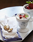 Greek yogurt with fresh berries in antique bowls