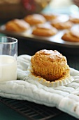 Freshly Baked Muffin with a Glass of Milk on an Oven Mitt