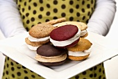 Woman Holding a Plate of Assorted Whoopie Pies