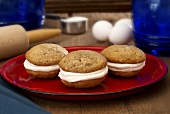 Three Banana Whoopie Pies on a Red Plate