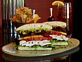 Large Chicken Club Sandwich; Halved; Potato Chips