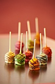 Cheesecake lollipops with chocolate stripes