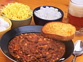 Venison chilli with three types of beans, garlic bread and beer