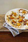 Persimmon, Prosciutto, and Pine Nut Pizza on a Plate
