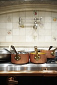 Various Copper Pots on Oven