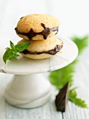 Vanilla Whoopie Pies with Dark Chocolate Ganache; On Marble Pedestal Dish