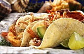 Fried Seafood Tacos in Corn Tortillas; Lime Wedges