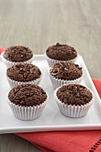 Chocolate Chip Brownie Cupcakes on a White Platter