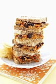 Peanut Butter, Carrot and Raisin Sandwiches on Wheat Bread; Stacked