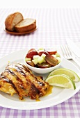 Grilled Citrus Chicken with Lime Wedges and Fruit Salad
