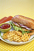 Fried Fish Sandwich with Waffles Fries and Ketchup