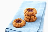 Peanut Butter and Jelly Cookies on a Blue Napkin