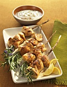 Grilled Chicken Skewers on Rosemary Branches; Dipped Sauce