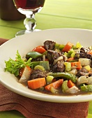 Bowl of Beef and Vegetable Soup; Glass of Red Wine