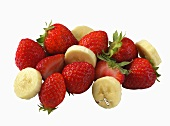 Strawberries and Banana Slices on a White Background