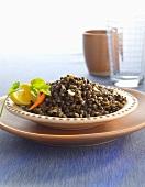 Bowl of Lentil Stew with Lemon Wedges