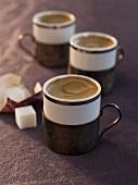 Three Cups of Espresso with Sugar Cubes