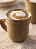 Latte in Ceramic Mug with Swirled Foam