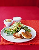 Potato cakes with apple sauce, sour cream and a side salad