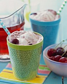 Cups of Cherry Ice Cream Sodas with Straws; Fresh Cherries