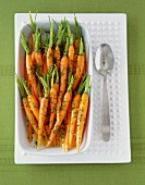Baby Carrots with Stems and Herbs in a Serving Bowl; From Above