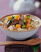 Red Curry Beef and Vegetables Over Rice; In a Bowl