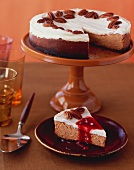 Sweet Potato Cheesecake on a Pedestal Dish with Slice Removed; Slice on a Plate