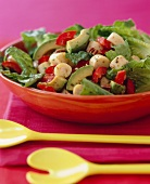 Heart of Palm Salad with Avocado and Red Bell Peppers; In a Serving Bowl; Yellow Salad Servers