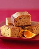 Pieces of Ginger Spice Cake with Orange on a Plate