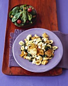 Orecchiette with Artichokes and Cheese on a Purple Plate; From Above