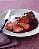 Partially Sliced Steak with Cherry Balsamic Sauce