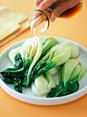 Drizzling Oil Over Bok Choy